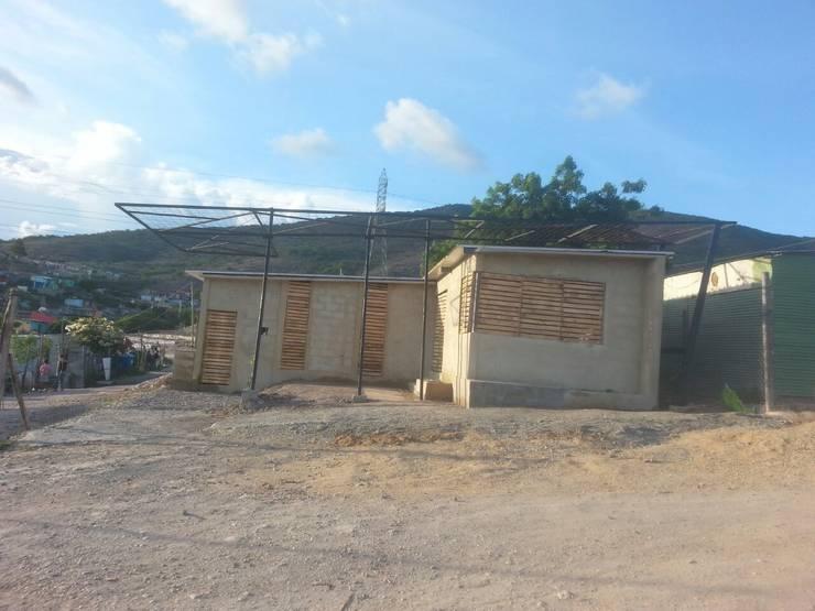 Progreso Fachada Vivienda : Casas de estilo minimalista por Taller de Desarrollo Urbano