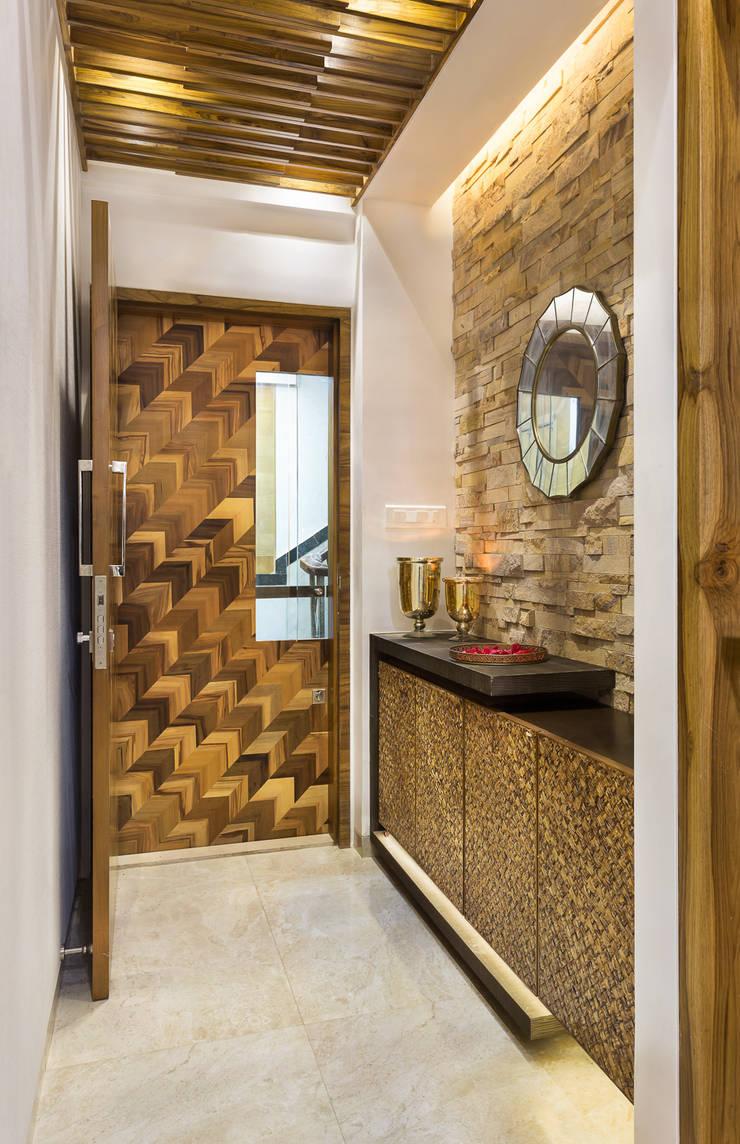 Warmly Lit Corridor :  Corridor & hallway by The design house