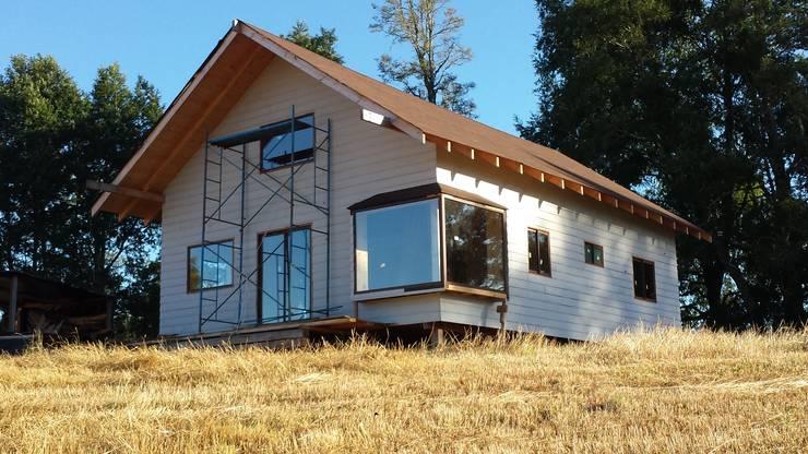 Houses by Arquitectura y Construcción Chinquel