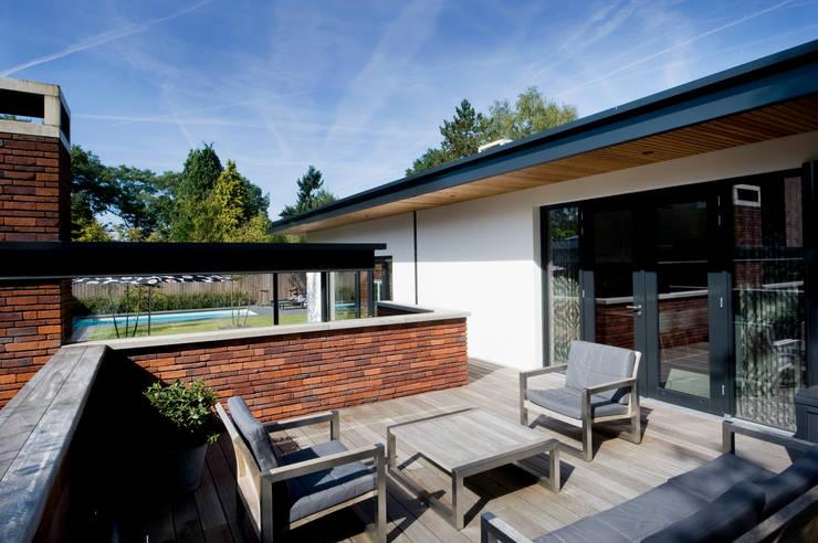 Doordachte lounge. :  Tuin door Heart for Gardens.