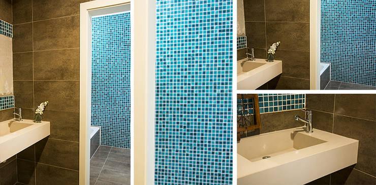 Casa en el Country: Baños de estilo  por Majo Barreña Diseño de Interiores,