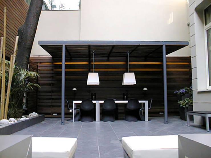 Madera, Hierro y Vidrio: Casas de estilo  por Majo Barreña Diseño de Interiores,
