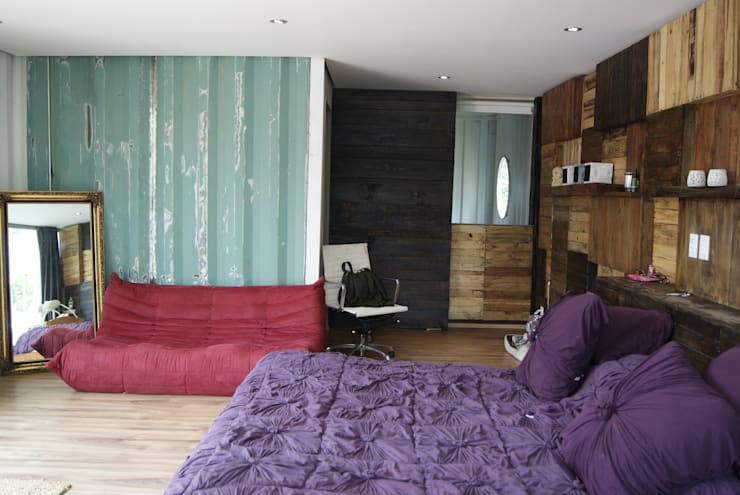 Dormitorios de estilo moderno por TARE arquitectos