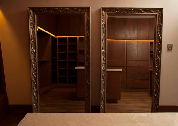 Closet Principal : Vestidores y closets de estilo moderno por Toyka Arquitectura