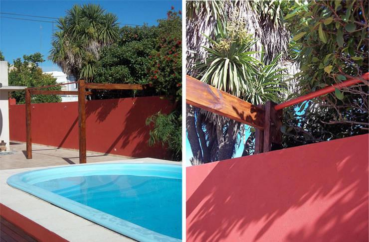 Madera y Lona: Casas de estilo  por Majo Barreña Diseño de Interiores,