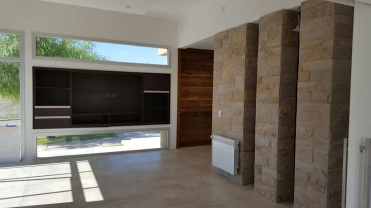 CASA DALVIAN M77: Livings de estilo minimalista por MABEL ABASOLO ARQUITECTURA