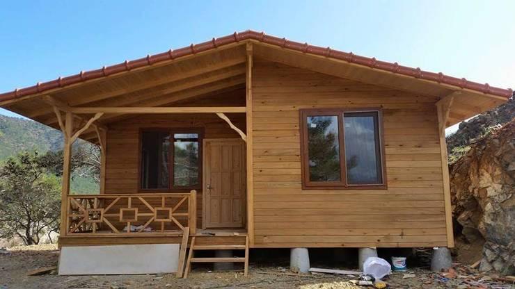 de estilo  por Ahşap bungalow