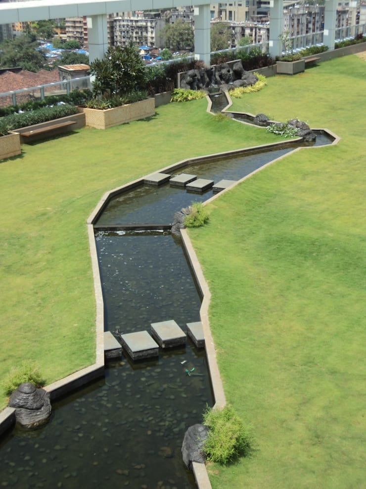 Tropical water body feature:  Commercial Spaces by Land Design landscape architects,