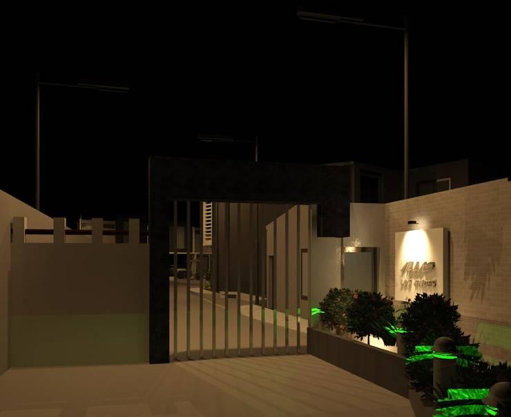 Vista nocturna del acceso del conjunto residencial: Casas de estilo  por Diseño Store