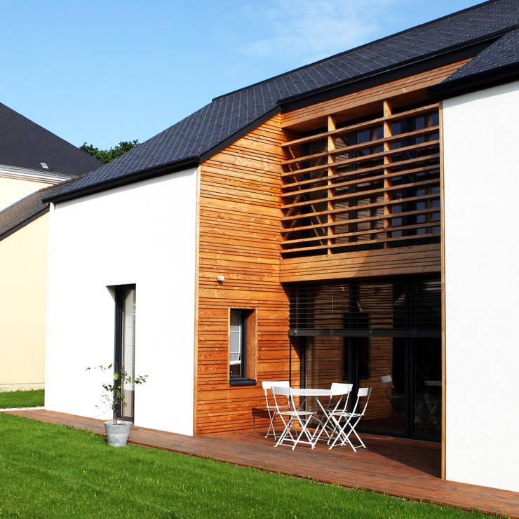 Maison bois G2 von yg-architecte | homify