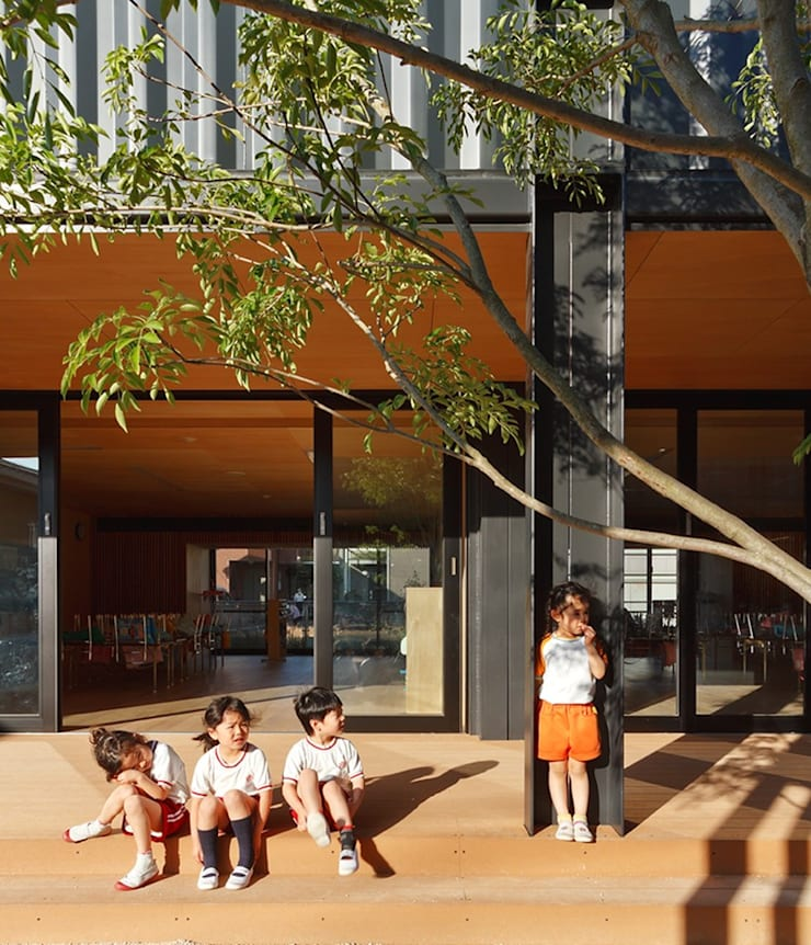 50-Year-Old Kindergarten Gets A Makeover With Shipping Containers:  Balconies, verandas & terraces  by Prefabmarket.com