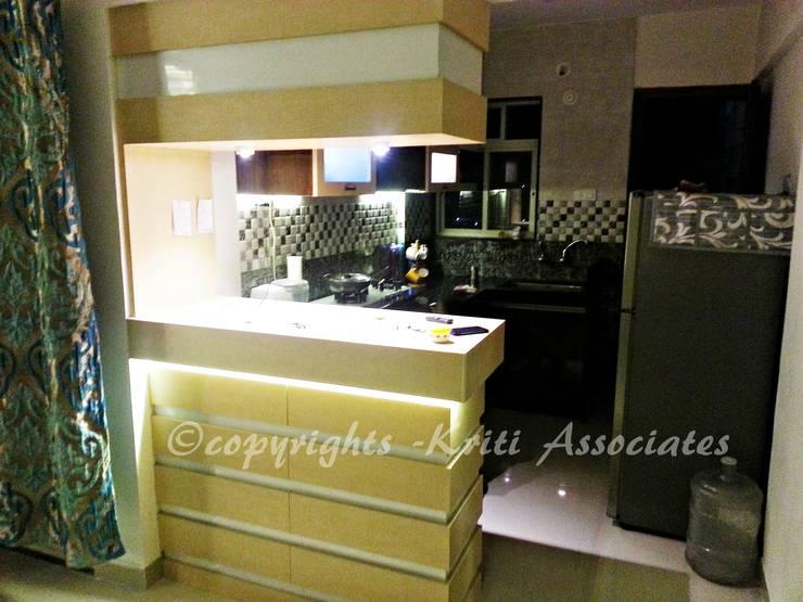 Interior: modern Kitchen by Kriti Associates / girishsdesigns