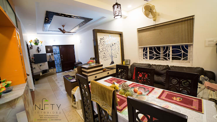 PA Bachupally Residence :  Dining room by Nifty Interio,Modern Wood Wood effect