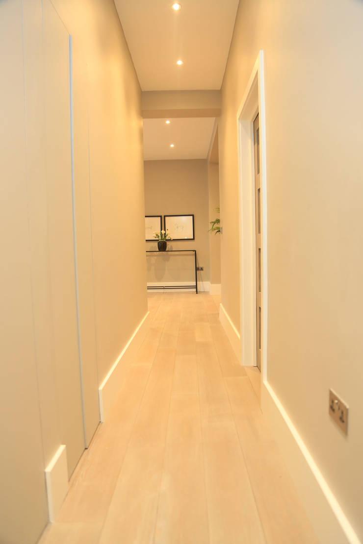 Full house renovation in Marylebone, London W1U:  Corridor & hallway by APT Renovation Ltd
