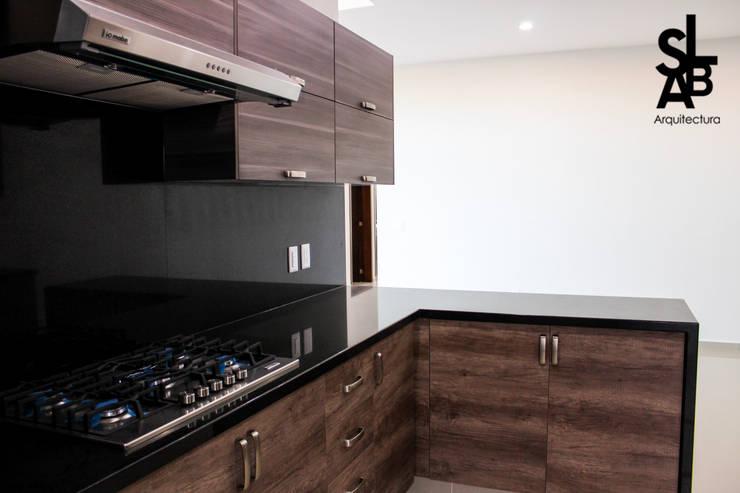 Cocinas de estilo  por Slab Arquitectos