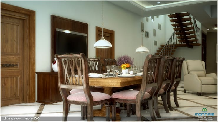 Grand & Striking: classic Dining room by Premdas Krishna