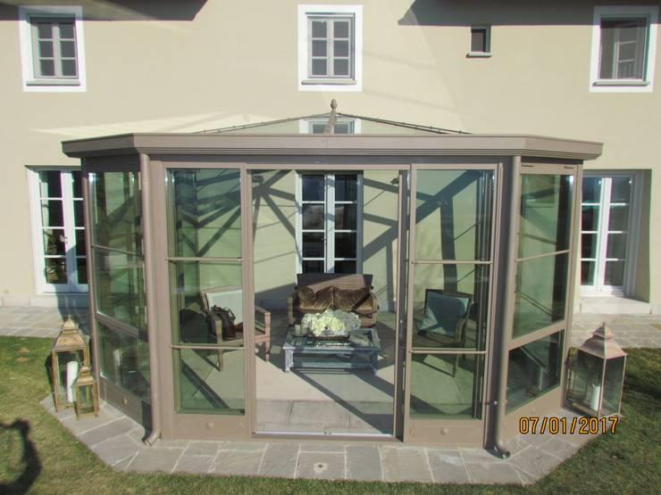 Serra Solare: Case in stile  di Studio Tecnico Progettisti Associati Ing. Marani Marco & Arch. Dei Claudia