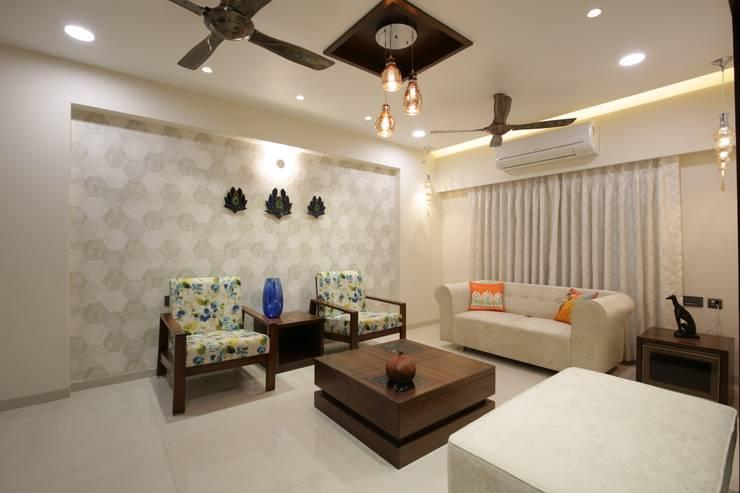 Mr vora's flat:  Living room by studio 7 designs