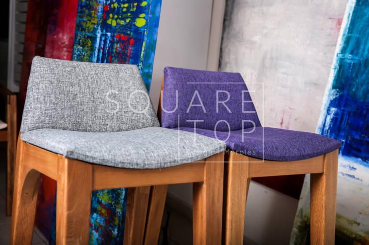 Silla Versiliana, telas y muchos colores. : Hogar de estilo  por SquareTop Design,