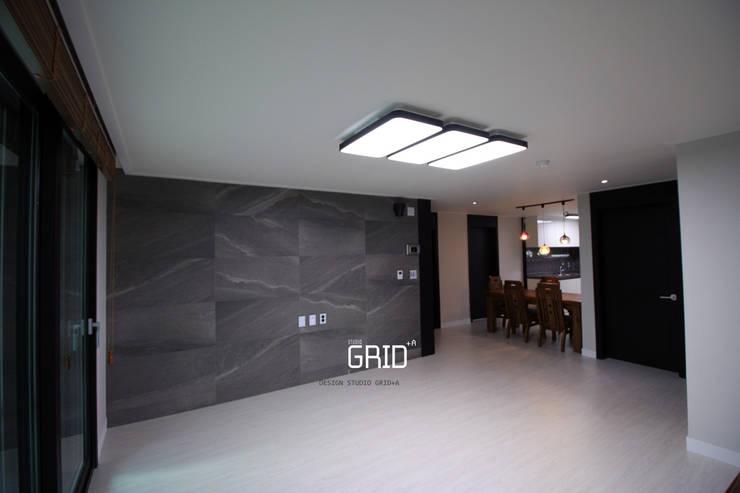 Living room by Design Studio Grid+A, Modern Tiles