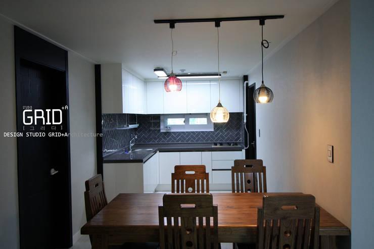 Dining room by Design Studio Grid+A, Modern