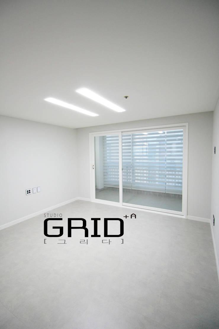 20평대 거실: Design Studio Grid+A의  거실,모던
