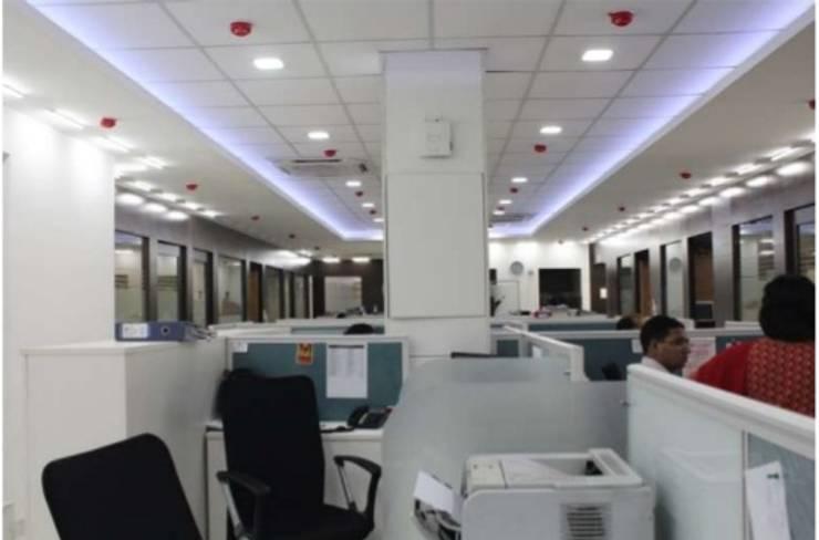 CORPORATE OFFICE INTERIORS, STATCON ENERGIA, NOIDA:   by DESINNOVA