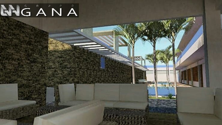 Lobby de acceso a la posada, techado y al aire libre permitiendo vista total del área recreativa: Hoteles de estilo  por Grupo GANA, C.A.