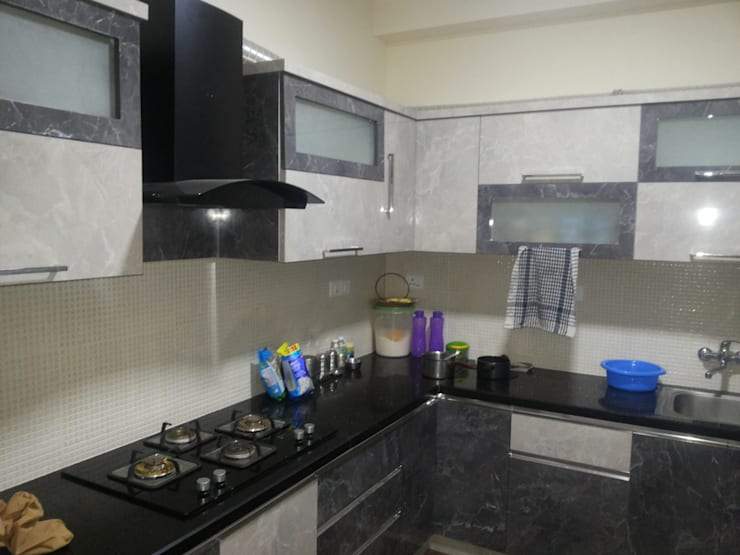 Interiors Residential:  Kitchen by Swastik Interiors