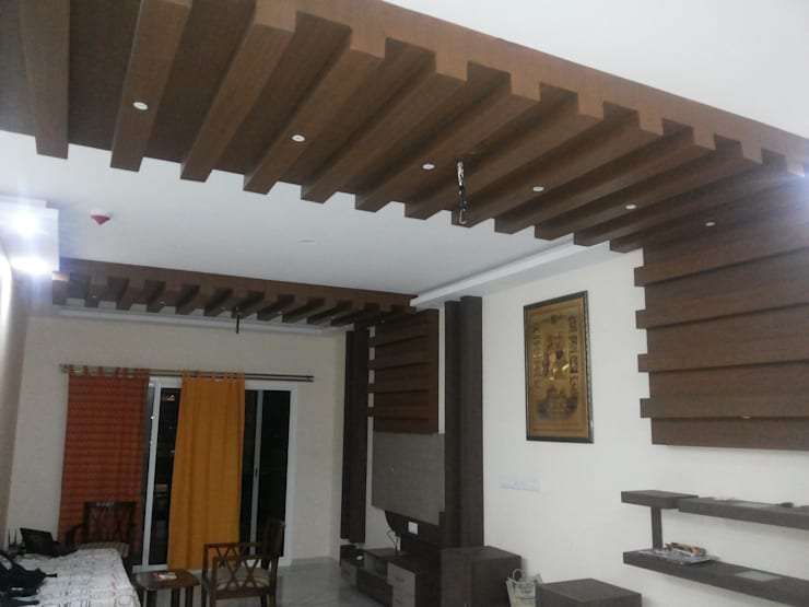 Interiors Residential:  Dining room by Swastik Interiors