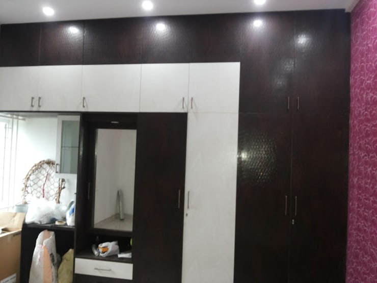 Interiors Residential:  Bedroom by Swastik Interiors