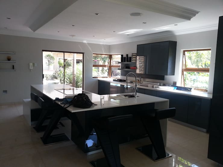 House Swaziland: modern Kitchen by Principia Design