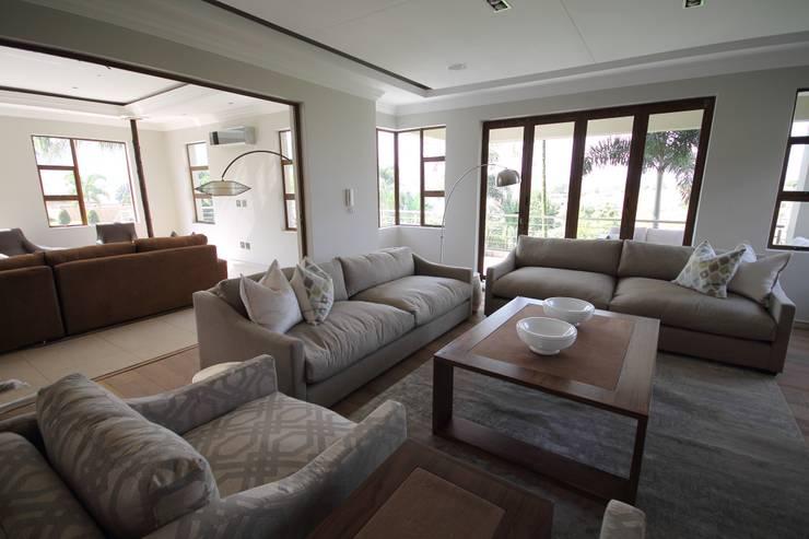 House Swaziland:  Living room by Principia Design