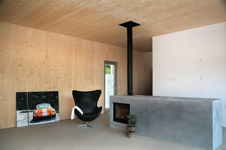 Einfamilienhaus Schöne Aussicht:  Wohnzimmer von Planungsgruppe Korb GmbH Architekten & Ingenieure