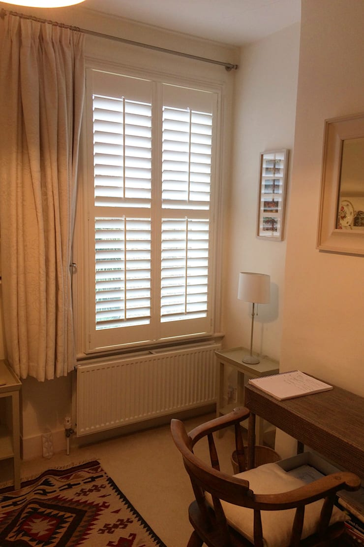 Full height shutters for bedroom windows:  Bedroom by Plantation Shutters Ltd