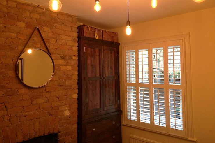 Full height shutters for sash windows:  Bedroom by Plantation Shutters Ltd