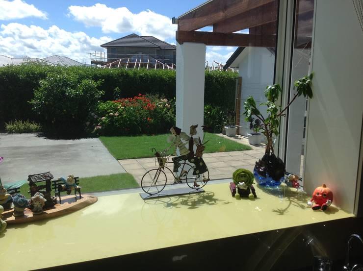 家聚昇溫:  庭院 by 耀昀創意設計有限公司/Alfonso Ideas