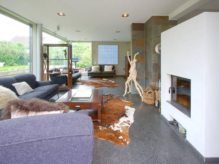 Projekty,  Salon zaprojektowane przez Gaus & Knödler Architekten