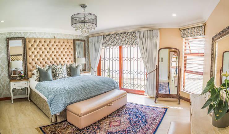 Bedroom. :  Bedroom by Carne Interiors