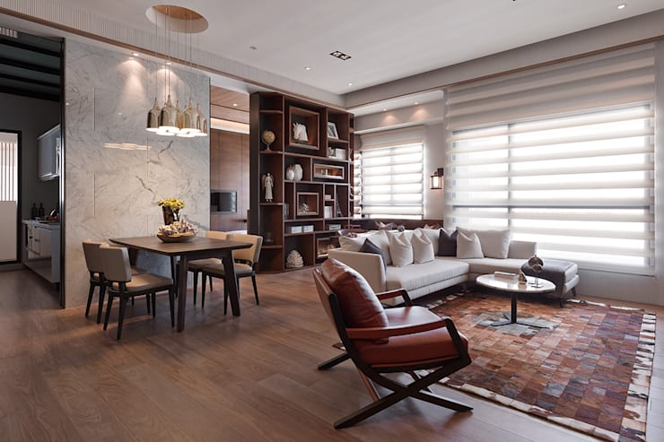 上河園:  客廳 by 大觀室內設計工程有限公司