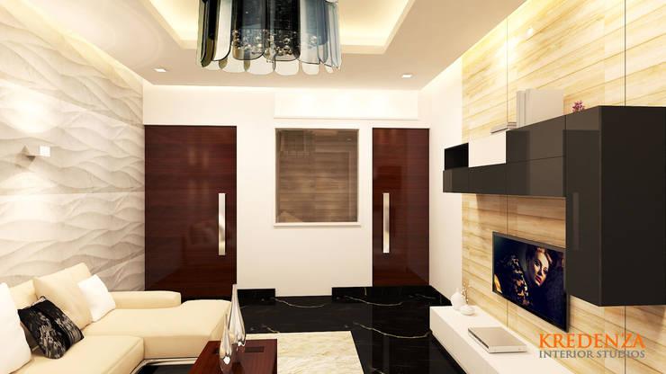 Living Area & Studio:  Living room by Kredenza Interior Studios,Modern