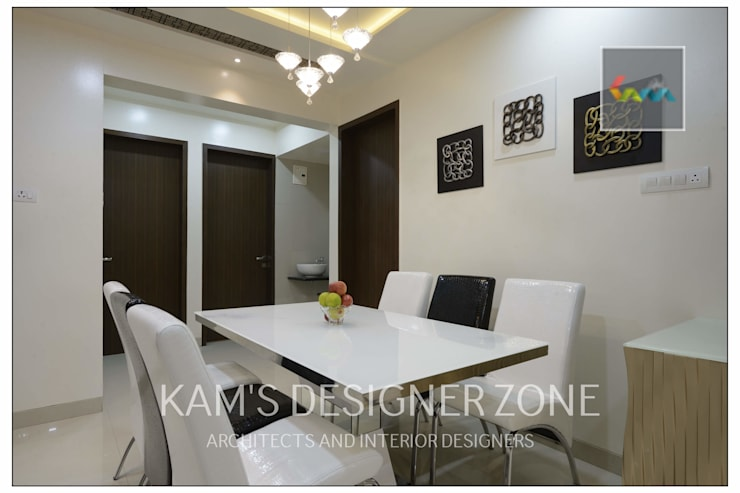 Apartment in Pharande L- Axis:  Dining room by KAM'S DESIGNER ZONE