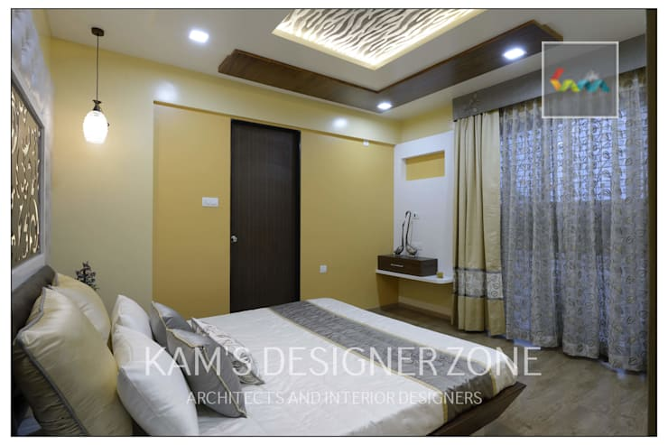 Apartment in Pharande L- Axis:  Bedroom by KAM'S DESIGNER ZONE