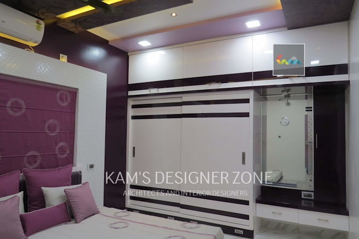 Home interior design for Mr. Aji John:  Walls by KAM'S DESIGNER ZONE