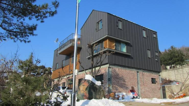 용인 주택 증축: Design Guild의  주택
