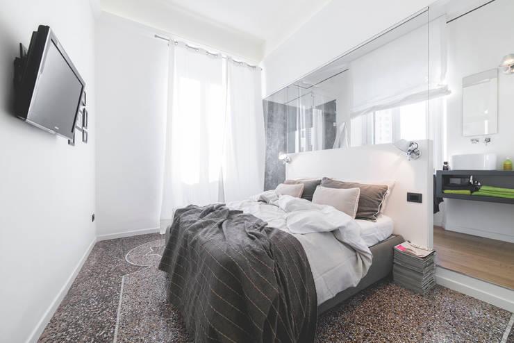 Спальни в . Автор – MODO Architettura