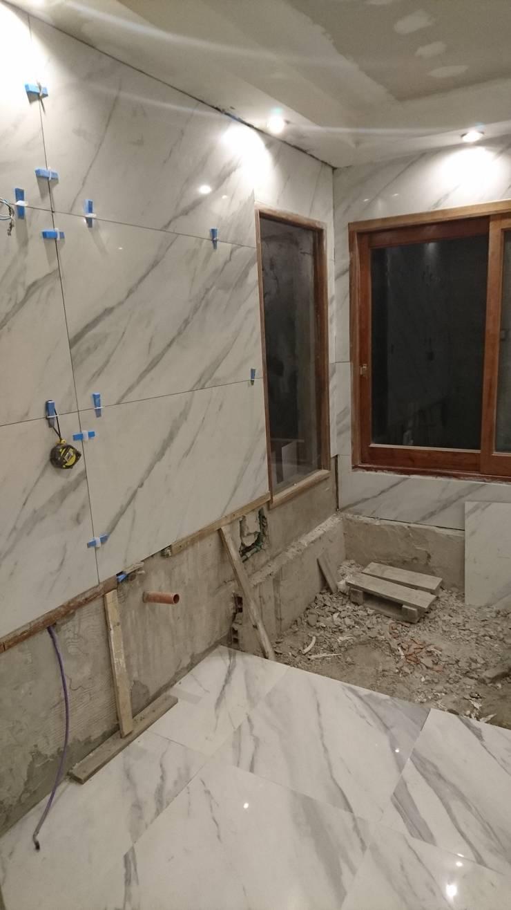 Baño en Suite: Baños de estilo  por Himis, Habis y Haim,