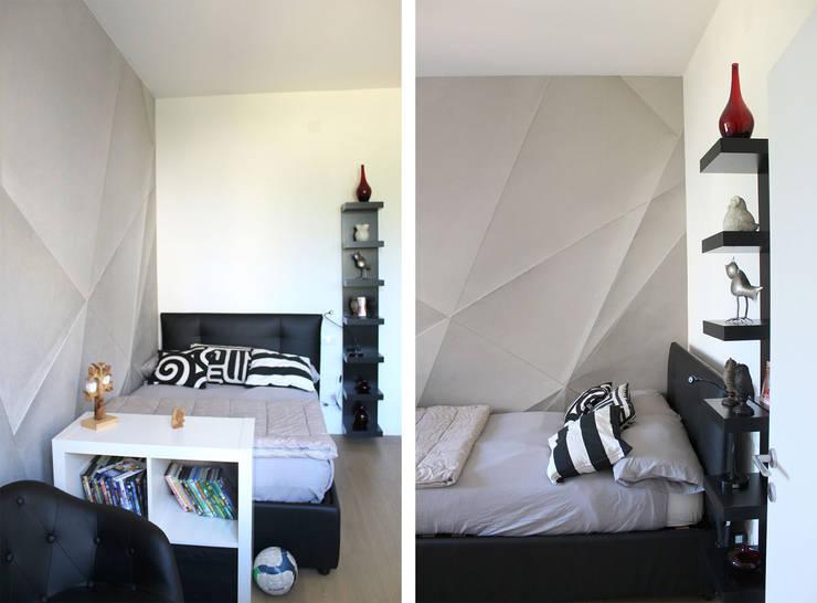 Cameretta: Camera da letto in stile in stile Moderno di redesign lab