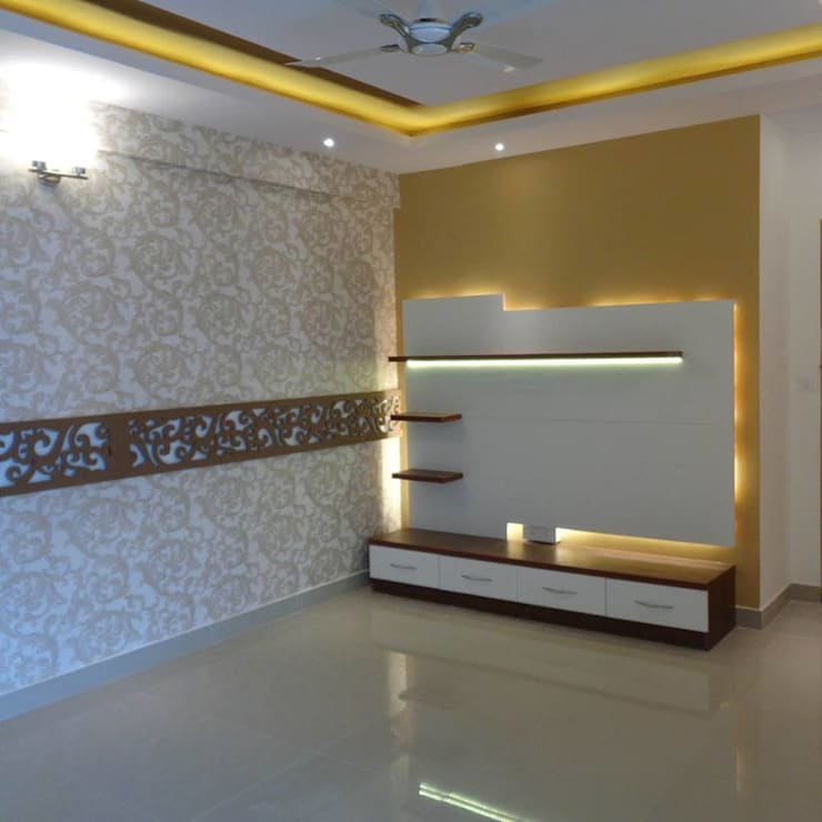 Living Room TV Unit & False Ceiling:  Living room by Scale Inch Pvt. Ltd.