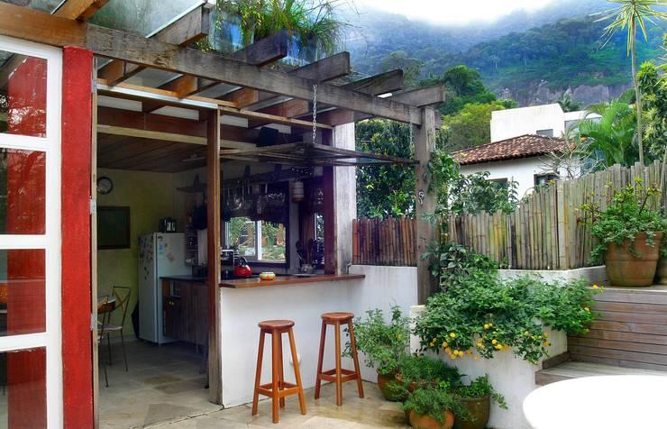 Casa Horto: Terraços  por Espaço Tania Chueke